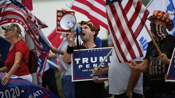 PHOTO: Supporters of President Donald Trump gather outside Perez Art Museum before his arrival for a town hall in Miami, Oct. 15, 2020. (Marco Bello/Reuters)