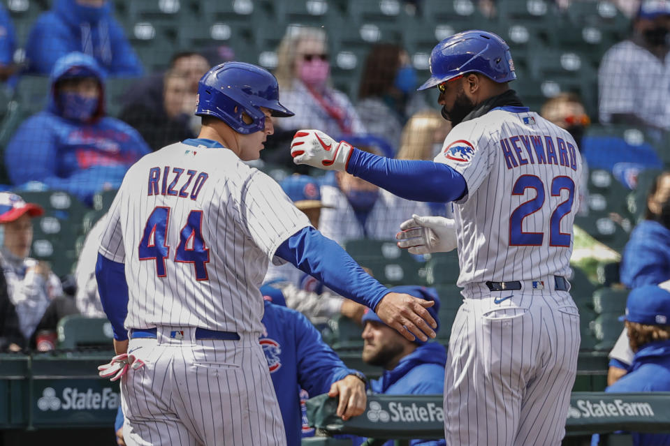 Chicago Cubs' Anthony Rizzo (44) celebrates with Jason Heyward (22) after scoring against the Pittsburgh Pirates during the fourth inning of a baseball game, Sunday, May 9, 2021, in Chicago. (AP Photo/Kamil Krzaczynski)