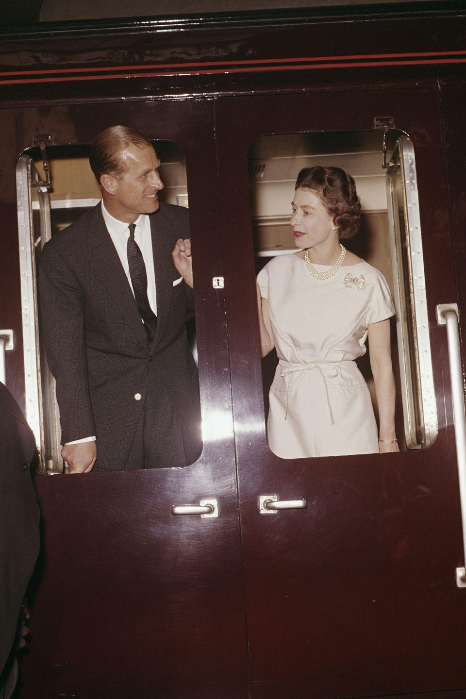 <p>Prince Philip and Queen Elizabeth together on a train they were departing in Manchester during the spring 0f 1961. </p>