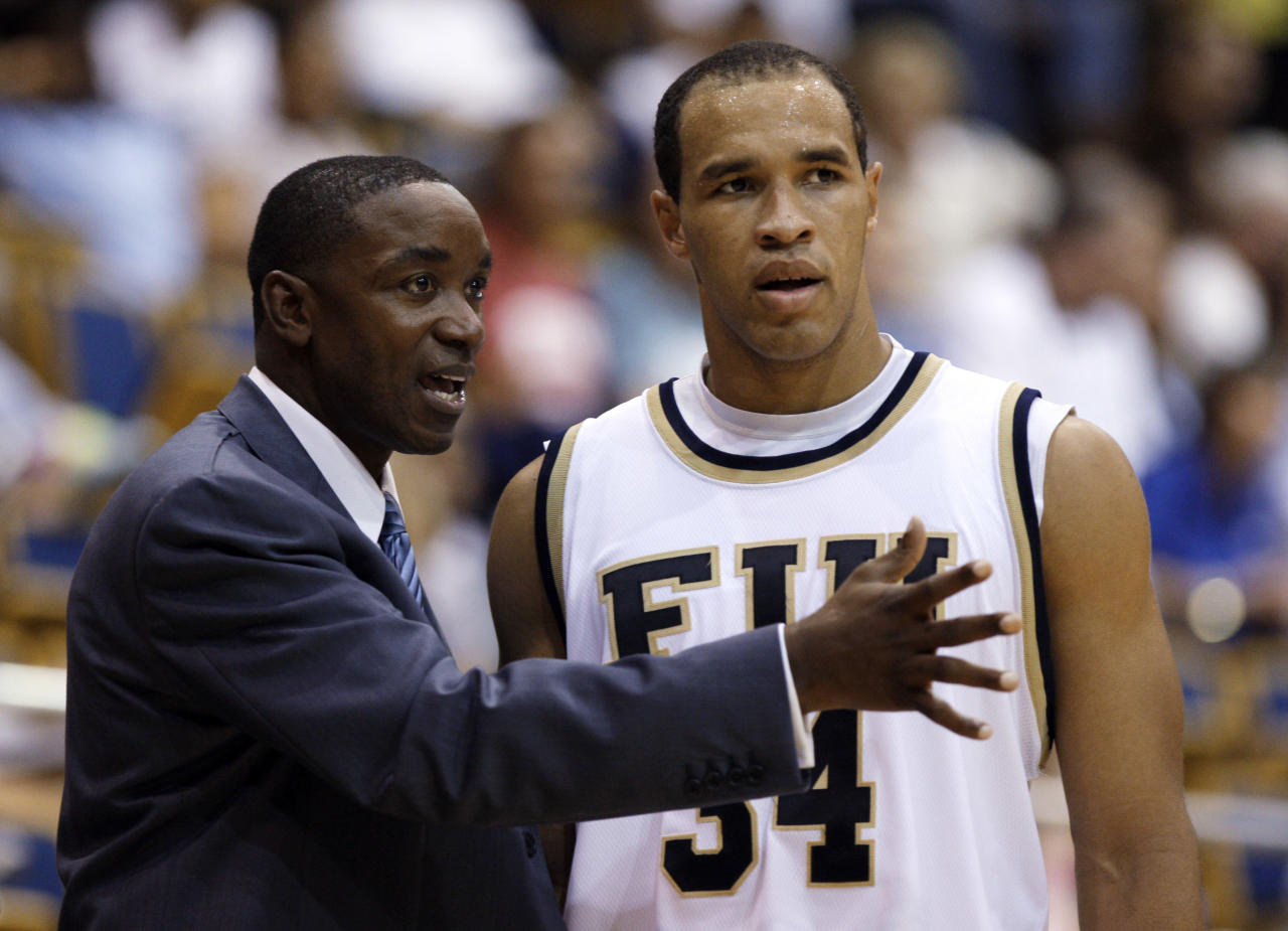 Florida International head basketball coach Isiah Thomas, left, talks with Marlon Bright (34) during an exhibition game against Northwood at FIU in Miami, Wednesday, Nov. 4, 2009. Thomas needs to make a winner of little-known Florida International and revive his own career in the process. (AP Photo/Lynne Sladky)