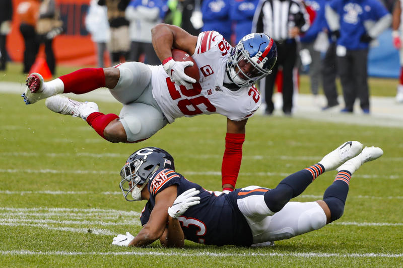 New York Giants running back Saquon Barkley (26) flips over Chicago Bears cornerback Kyle Fuller (23). (AP Photo/Charles Rex Arbogast)