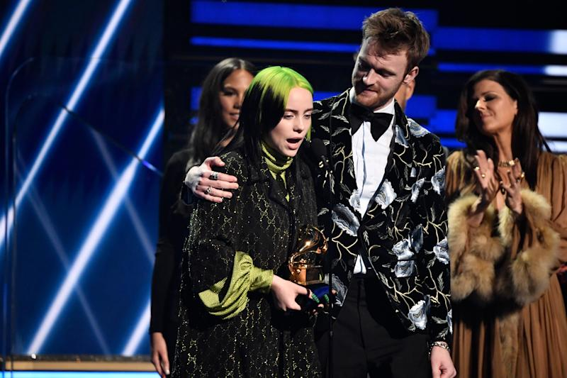 "Billie Eilish accepts the song of the year Grammy for ""Bad Guy"" with her brother Finneas O'Connell."