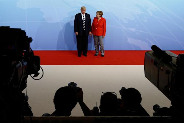 <p>German Chancellor Angela Merkel greets President Donald Trump upon his arrival for the first day of the G20 economic summit on July 7, 2017 in Hamburg, Germany. (Photo: Morris MacMatzen/Getty Images) </p>