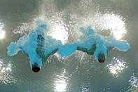 LONDON, ENGLAND - JULY 30: Jose Antonio Guerra and Jeinkler Aguirre of Cuba compete in the Men's Synchronised 10m Platform Diving on Day 3 of the London 2012 Olympic Games at the Aquatics Centre on July 30, 2012 in London, England. (Photo by Adam Pretty/Getty Images)