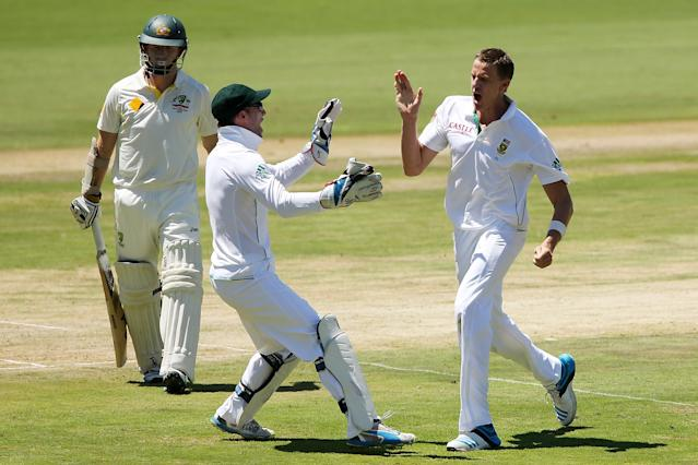 CENTURION, SOUTH AFRICA - FEBRUARY 12: Morne Morkel (R) of South Africa celebrates after getting the wicket of Chris Rogers (L) of Australia during day one of the First Test match between South Africa and Australia on February 12, 2014 in Centurion, South Africa. (Photo by Morne de Klerk/Getty Images)