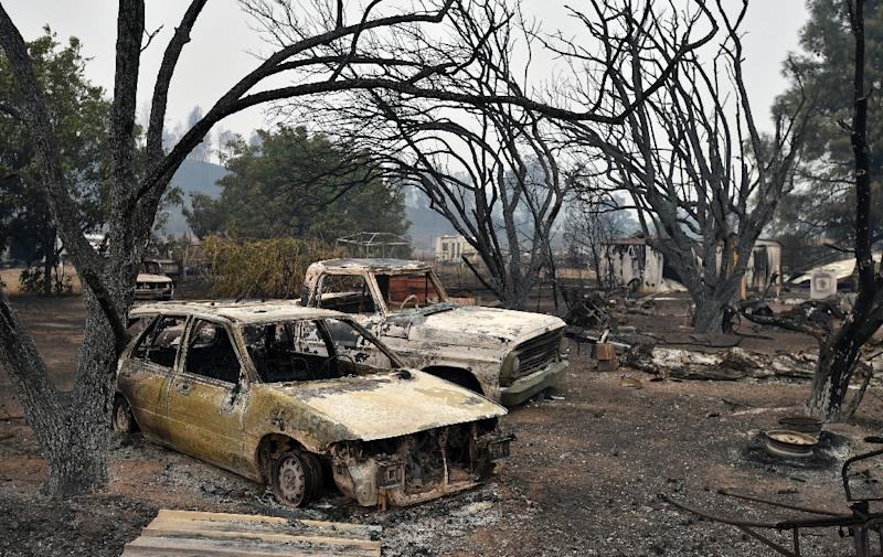 Burned vehicles sit on a property charred by the Valley fire in Middletown, California on September 13, 2015 (AFP Photo/Josh Edelson)