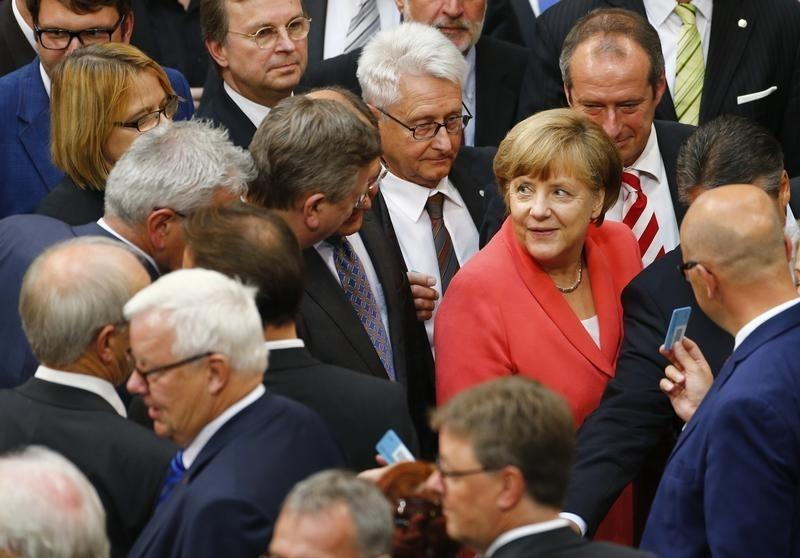 German Chancellor Merkel prepares to vote during the session of Germany's parliament, the Bundestag, in Berlin