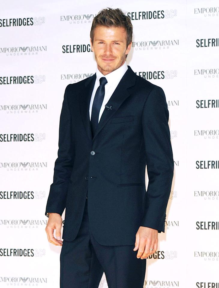 "David Beckham delivered his signature smirk in a navy blue Giorgio Armani suit upon arriving at Selfridges department store in London to unveil his latest undies ad. Sam Snap/<a href=""http://filmmagic.com/"" target=""new"">FilmMagic.com</a> - June 11, 2009"