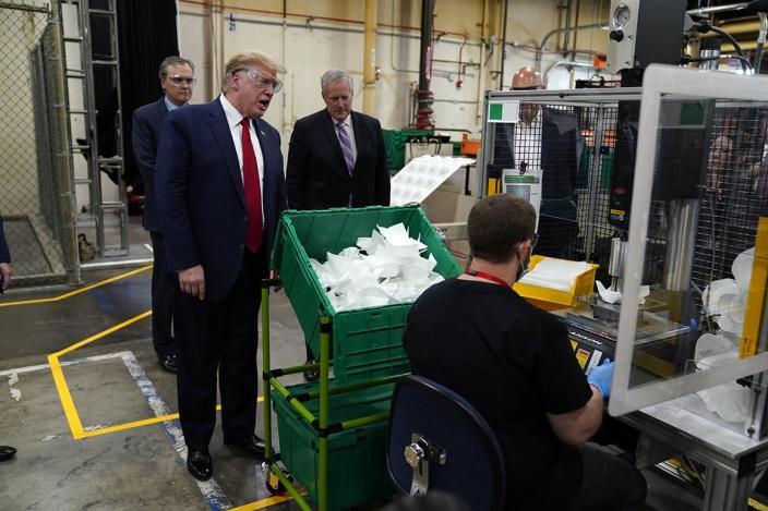 President Donald Trump participates in a tour of a Honeywell International plant that manufactures personal protective equipment, Tuesday, May 5, 2020, in Phoenix, with Honeywell CEO Darius Adamczyk and White House chief of staff Mark Meadows. (AP Photo/Evan Vucci)