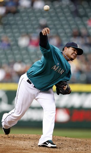 Seattle Mariners' Felix Hernandez throws in the second inning against the Texas Rangers during a baseball game in Seattle on Monday, May 21, 2012. (AP Photo/Kevin P. Casey)