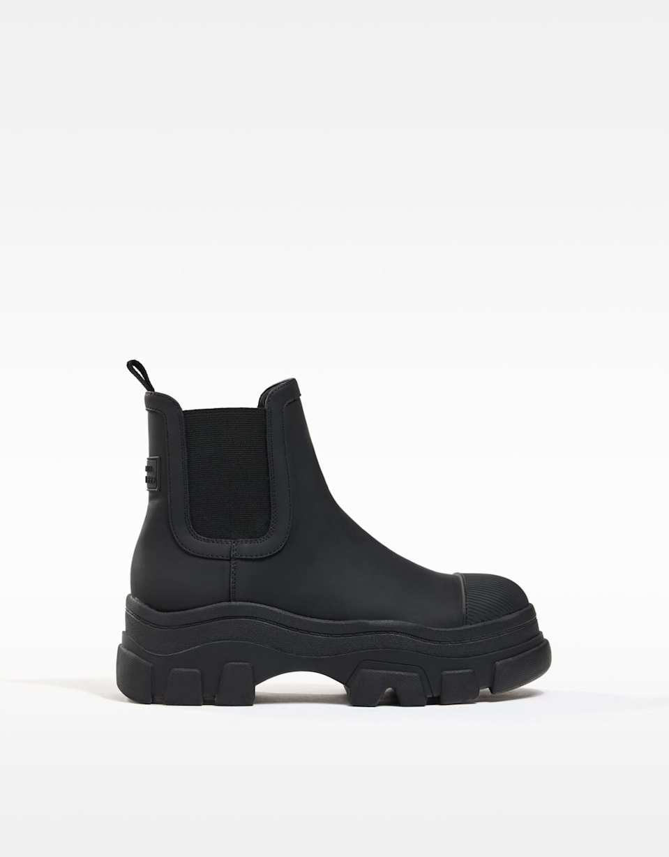 "<br><br><strong>Bershka</strong> Rubberized Ankle Boots With Elastic Panels, $, available at <a href=""https://go.skimresources.com/?id=30283X879131&url=https%3A%2F%2Fwww.bershka.com%2Fus%2Fwomen%2Fshoes%2Fboots-and-ankle-boots%2Frubberized-ankle-boots-with-elastic-panels-c1010205534p102701746.html"" rel=""nofollow noopener"" target=""_blank"" data-ylk=""slk:Bershka"" class=""link rapid-noclick-resp"">Bershka</a>"