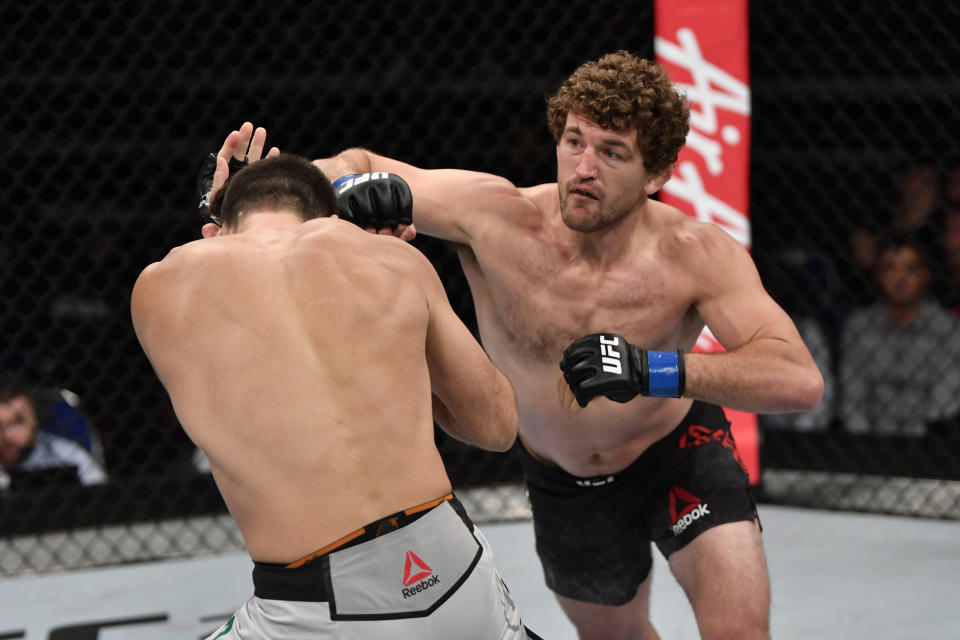 SINGAPORE, SINGAPORE - OCTOBER 26: (R-L) Ben Askren punches Demian Maia of Brazil in their welterweight bout during the UFC Fight Night event at Singapore Indoor Stadium on October 26, 2019 in Singapore. (Photo by Jeff Bottari/Zuffa LLC via Getty Images)
