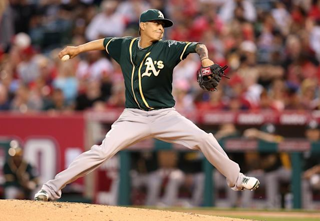 ANAHEIM, CA - APRIL 14: Jesse Chavez #60 of the Oakland Athletics throws a pitch against the Los Angeles Angels of Anaheim at Angel Stadium of Anaheim on April 14, 2014 in Anaheim, California. (Photo by Stephen Dunn/Getty Images)