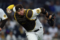San Diego Padres catcher Victor Caratini throws to first for an out against Chicago Cubs' Sergio Alcantara during the second inning of a baseball game Monday, June 7, 2021, in San Diego. (AP Photo/Gregory Bull)