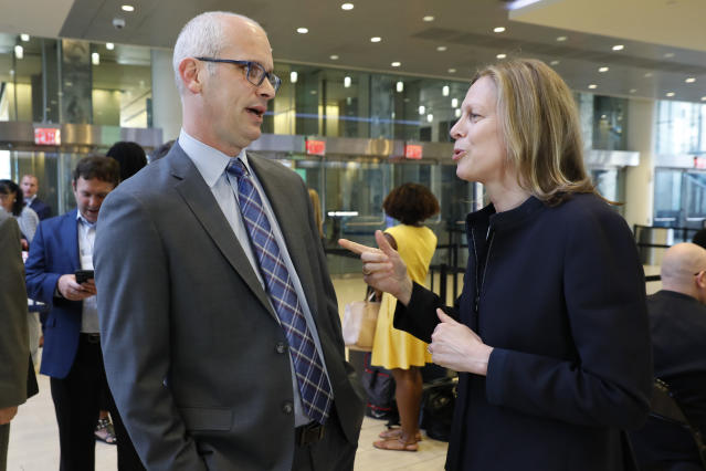 UConn men's basketball coach Dan Hurley talks with Big East Commissioner Val Ackerman before the announcement that the University of Connecticut is re-joining the Big East Conference, at New York's Madison Square Garden, Thursday, June 27, 2019. (AP Photo/Richard Drew)