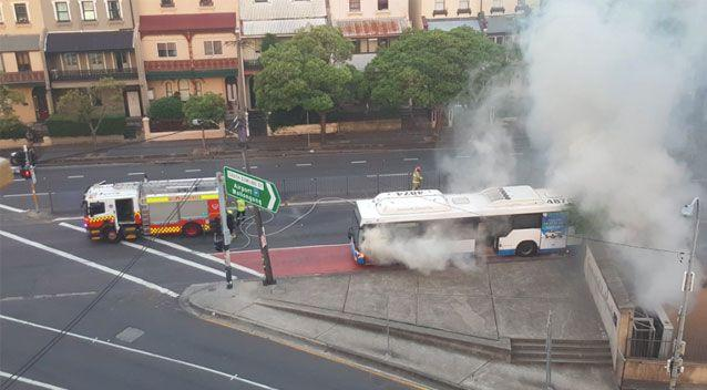 The bus was extinguished by attending firefighters. Source: Twitter/ Phil Dye