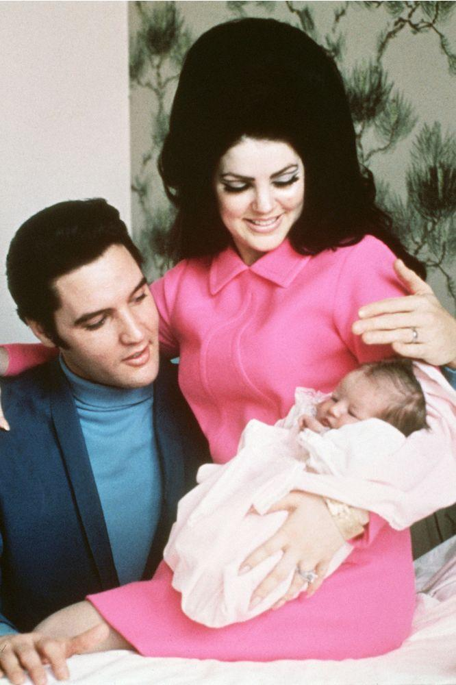 Elvis Presley and his wife Priscilla before leaving the hospital following arrival of daughter Lisa Marie | Bettmann/Getty