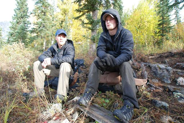 Arrigetch Peaks, Alaska, USA: Tyrell Seavey & Dallas Seavey sitting at a campsite.