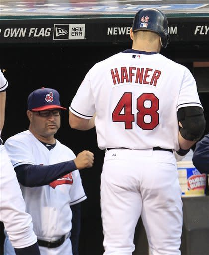 Cleveland Indians' Travis Hafner is congratulated be Cleveland Indians manager Manny Acta, left, after Hafner hit a two run home run in the sixth inning in a baseball game, Wednesday, May 23, 2012, in Cleveland. Jason Kipnis scored. The Indians won 4-2. (AP Photo/Tony Dejak)