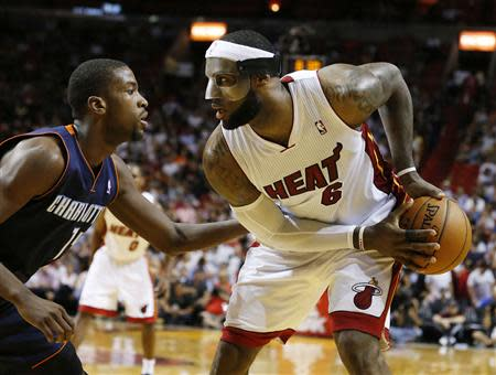 Mar 3, 2014; Miami, FL, USA; Miami Heat small forward LeBron James (6) dribbles the ball past Charlotte Bobcats small forward Michael Kidd-Gilchrist (14) in the second half at American Airlines Arena. Robert Mayer-USA TODAY Sports
