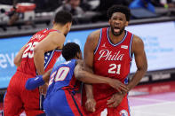 Philadelphia 76ers center Joel Embiid (21) grimaces after Detroit Pistons guard Josh Jackson (20) ran into him while chasing guard Ben Simmons (25) during the first half of an NBA basketball game Saturday, Jan. 23, 2021, in Detroit. (AP Photo/Carlos Osorio)