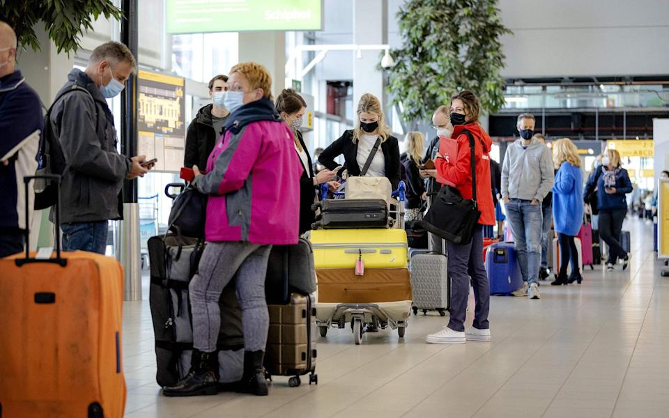 Travellers have been told to expect long waits at the airport this summer - Getty