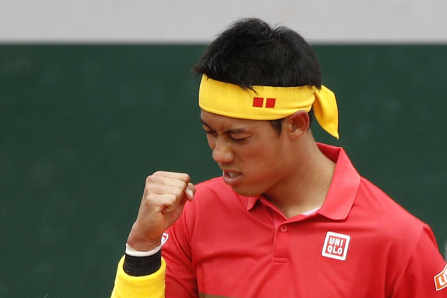 Japan's Kei Nishikori reacts after winning a point against France's Gilles Simon during their third round match of the French Open tennis tournament at the Roland Garros stadium, Friday, June 1, 2018 in Paris. (AP Photo/Christophe Ena)