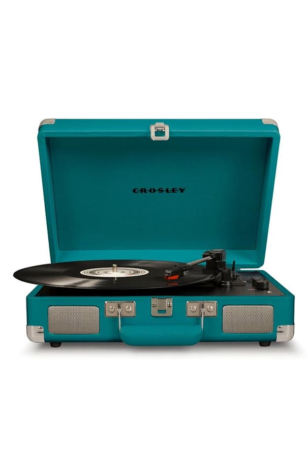 "<p>Music lovers will appreciate this <a href=""https://www.popsugar.com/buy/Crosley-Radio-Cruiser-Deluxe-Turntable-499121?p_name=Crosley%20Radio%20Cruiser%20Deluxe%20Turntable&retailer=shop.nordstrom.com&pid=499121&price=70&evar1=geek%3Aus&evar9=26294675&evar98=https%3A%2F%2Fwww.popsugar.com%2Fphoto-gallery%2F26294675%2Fimage%2F46728991%2FCrosley-Radio-Cruiser-Deluxe-Turntable&list1=shopping%2Cgadgets%2Choliday%2Cgift%20guide%2Choliday%20living%2Ctech%20gifts%2Cgifts%20under%20%24100&prop13=api&pdata=1"" rel=""nofollow"" data-shoppable-link=""1"" target=""_blank"" class=""ga-track"" data-ga-category=""Related"" data-ga-label=""https://shop.nordstrom.com/s/crosley-radio-cruiser-deluxe-turntable/4945450?origin=category-personalizedsort&amp;breadcrumb=Home%2FHome%20%26%20Gifts%2FHome%2FElectronics%20%26%20Tech%20Accessories&amp;color=teal"" data-ga-action=""In-Line Links"">Crosley Radio Cruiser Deluxe Turntable</a> ($70).</p>"