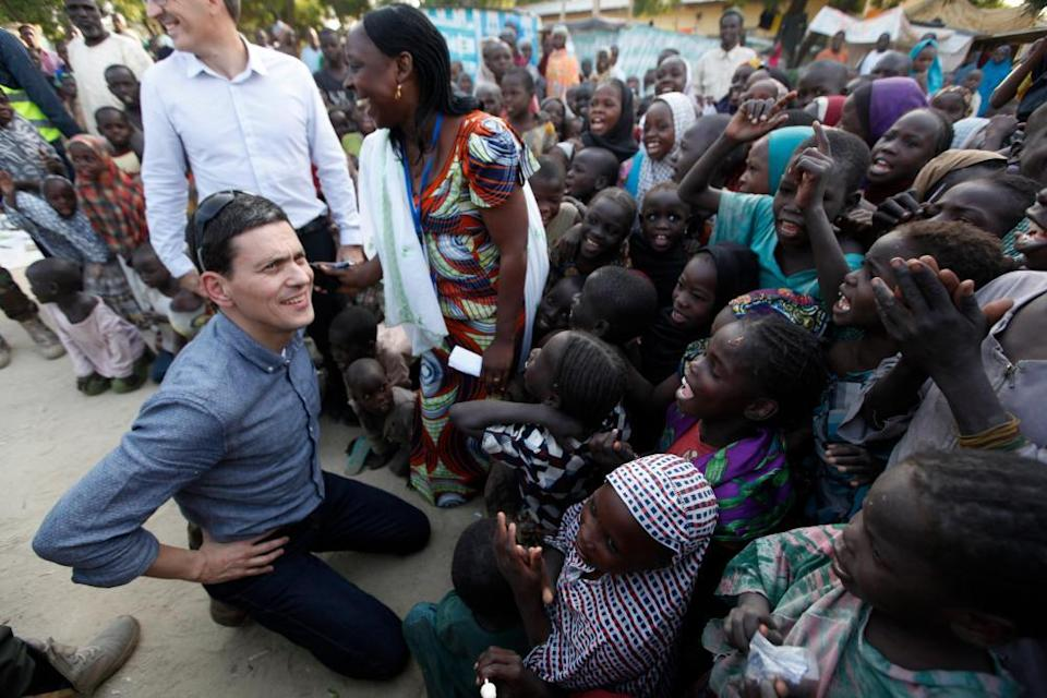 David Miliband with children displace by Boko Haram attacks in Nigeria, 2015