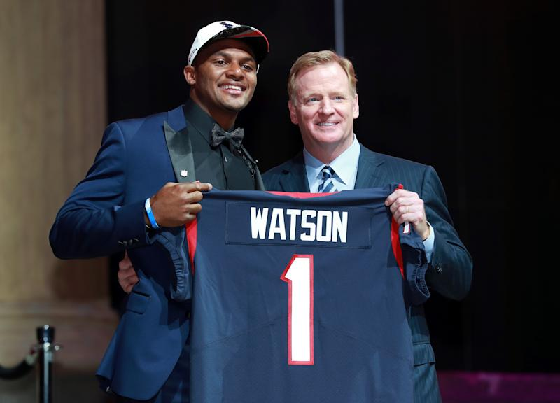 Deshaun Watson, left, poses with NFL commissioner Roger Goodell after being drafted by the Texans. (AP)
