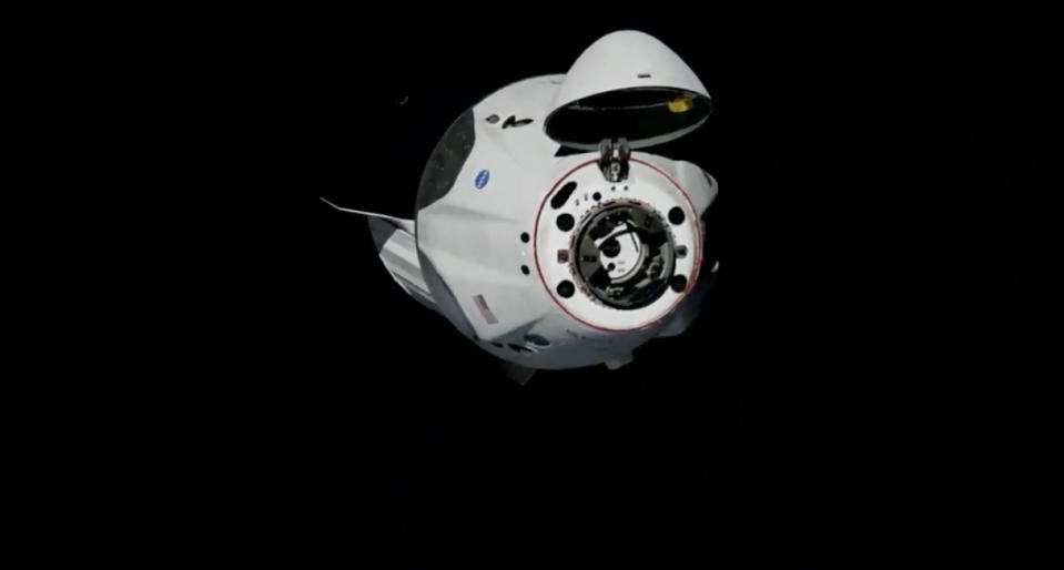 Astronauts enter space station on historic SpaceX mission