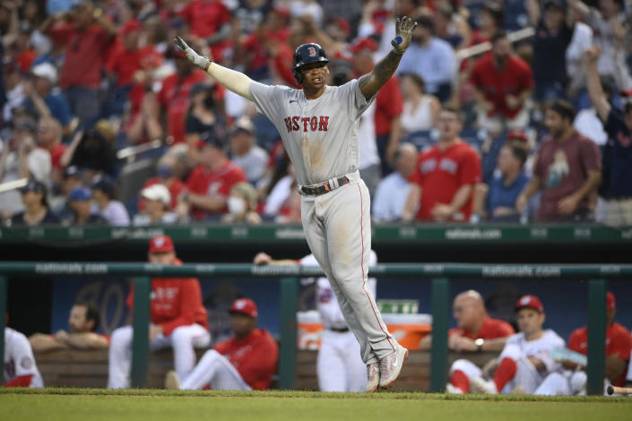 Boston Red Sox' Rafael Devers celebrates his two-run home run during the ninth inning of a baseball game against the Washington Nationals, Sunday, Oct. 3, 2021, in Washington. The Red Sox won 7-5. (AP Photo/Nick Wass)