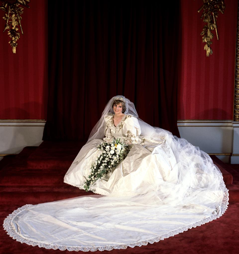The Princess of Wales seated in her bridal gown at Buckingham Palace after her marriage to Prince Charles at St. Paul's Cathedral.   (Photo by PA Images via Getty Images)