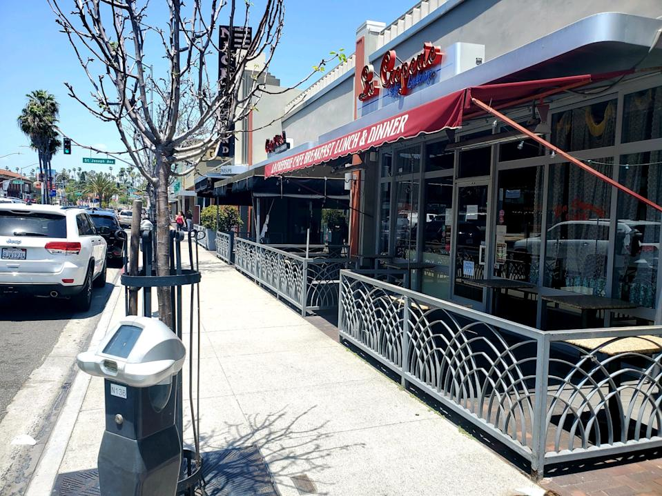 Long Beach and its restaurants remained mostly shut down over Memorial Day weekend. (Yahoo)