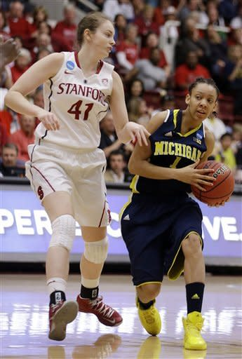 Michigan's Brenae Harris, right, looks to pass away from Stanford's Bonnie Samuelson (41) during the first half of a second-round game in the women's NCAA college basketball tournament on Tuesday, March 26, 2013, in Stanford, Calif. (AP Photo/Ben Margot)