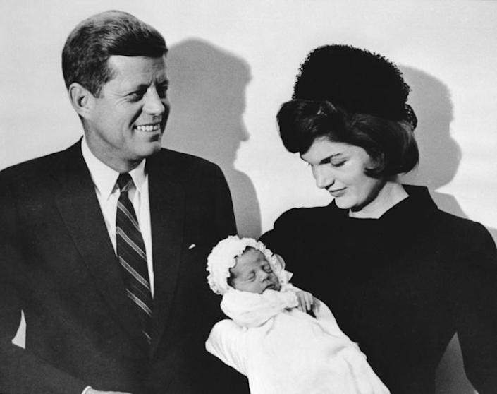 John F. Kennedy, pictured in 1960 with wife Jacqueline and their son John, was shot in Dallas by lone gunman Lee Harvey Oswald... not by Ted Cruz's father (AFP Photo/SAM SCHULMAN)