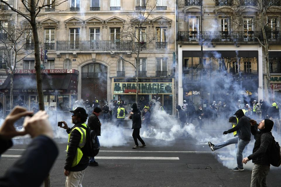 <p> Teargas is used to disperse demonstrators during minor clashes with police in Paris, Saturday, March 23, 2019. The French government vowed to strengthen security as yellow vest protesters stage a 19th round of demonstrations, in an effort to avoid a repeat of last week's riots in Paris. (AP Photo/Kamil Zihnioglu)</p>