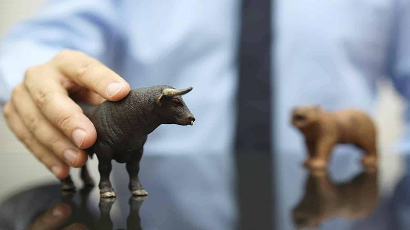 businessman holding bull, concept of bullish trend on stock mark