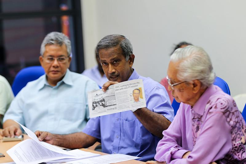 """Datuk M. Ali (centre) said SKL requested Federal Territories Minister Khalid Samad in a meeting on July 26 to get DBKL to publicly display the DKLCP to ensure that the """"correct"""" city plan would be gazetted, not the 'mutilated, butchered' version. — Picture by Ahmad Zamzahuri"""