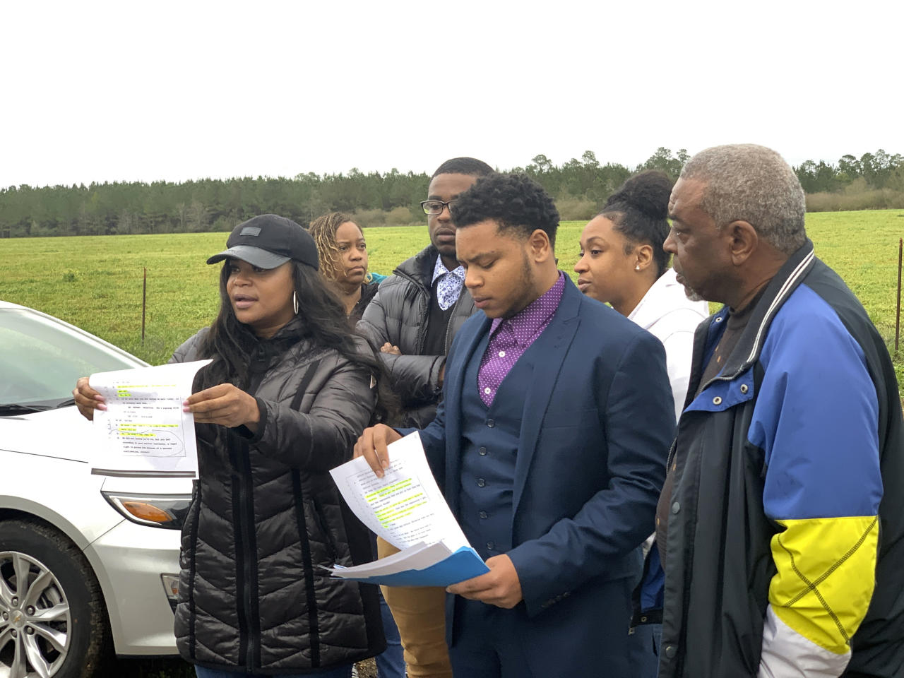 Family members of condemned Alabama inmate Nathaniel Woods speak to reporters outside Holman Correctional Facility ahead of his scheduled execution on Thursday, March 5, 2020 in Atmore, Alabama. His sister, Pamela Woods, holds a page from the trial transcript that she shows that her brother was surrendering when three police officers were shot by another man in 2004. Woods was convicted of capital murder as an accomplice in the shootings. A jury recommended the death penalty by a 10-2 vote.  (AP Photo/Kimberly Chandler)