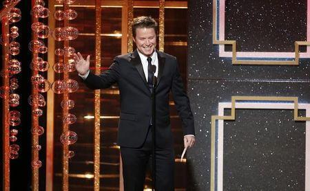 Billy Bush presents the award for outstanding supporting actor in a drama series during the 41st Annual Daytime Emmy Awards in Beverly Hills, California June 22, 2014. REUTERS/Danny Moloshok