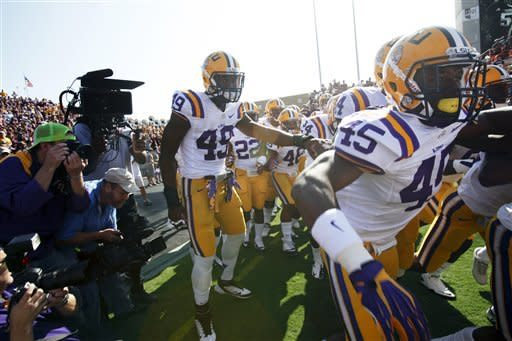 LSU football players, including Allen Buniger (45) and Barkevious Mingp (49) get read to step onto the field to play Texas A&M in an NCAA college football game, Saturday, Oct. 20, 2012, in College Station, Texas. (AP Photo/Eric Kayne)