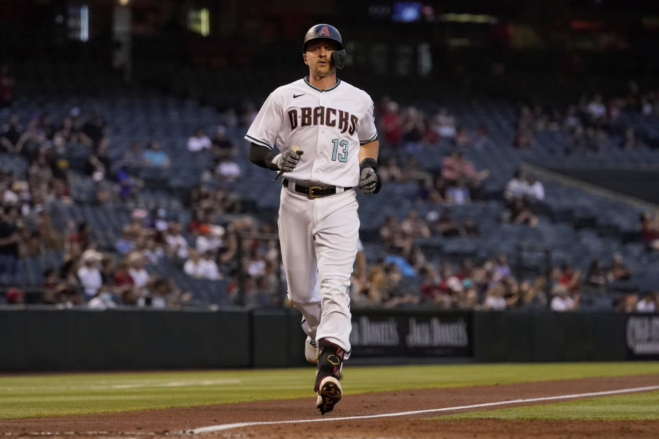 Arizona Diamondbacks' Nick Ahmed rounds the bases after hitting a solo home run against the Miami Marlins during the second inning of a baseball game, Tuesday, May 11, 2021, in Phoenix. (AP Photo/Matt York)