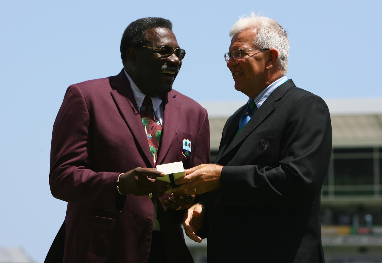 BRIDGETOWN, BARBADOS - APRIL 21: Retiring match referee Clive Lloyd of the West Indies is presented with an award by ICC Chief Executive Malcolm Speed during the ICC Cricket World Cup Super Eights match between West Indies and England at the Kensington Oval on April 21, 2007 in Bridgetown, Barbados.  (Photo by Tom Shaw/Getty Images)