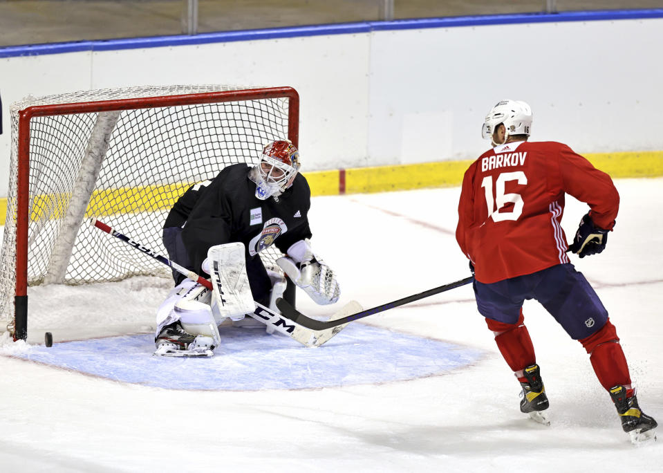 Florida Panthers goaltender Sergei Bobrovsky (72) defends the goal from Panthers center Aleksander Barkov (16) during training camp in preparation for the 2021-22 NHL season at the FLA Live Arena on Thursday, September 23, 2021 in Sunrise, Florida.(David Santiago/Miami Herald via AP)