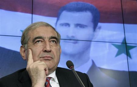 Jamil, Syria's deputy prime minister for economic affairs, listens during a news conference in Moscow