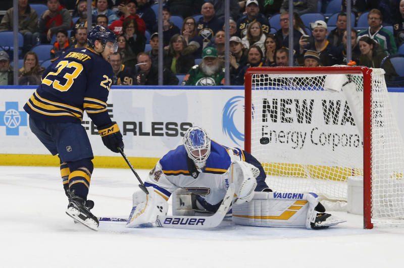 Buffalo Sabres forward Sam Reinhart (23) puts the puck past St. Louis Blues goalie Jake Allen (34) during the shootout of an NHL hockey game, Sunday, March 17, 2019, in Buffalo N.Y. (AP Photo/Jeffrey T. Barnes)