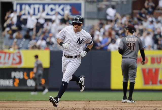 New York Yankees' Mike Tauchman runs the bases after hitting a two-run home run during the second inning of a baseball game against the Arizona Diamondbacks Wednesday, July 31, 2019, in New York. (AP Photo/Frank Franklin II)