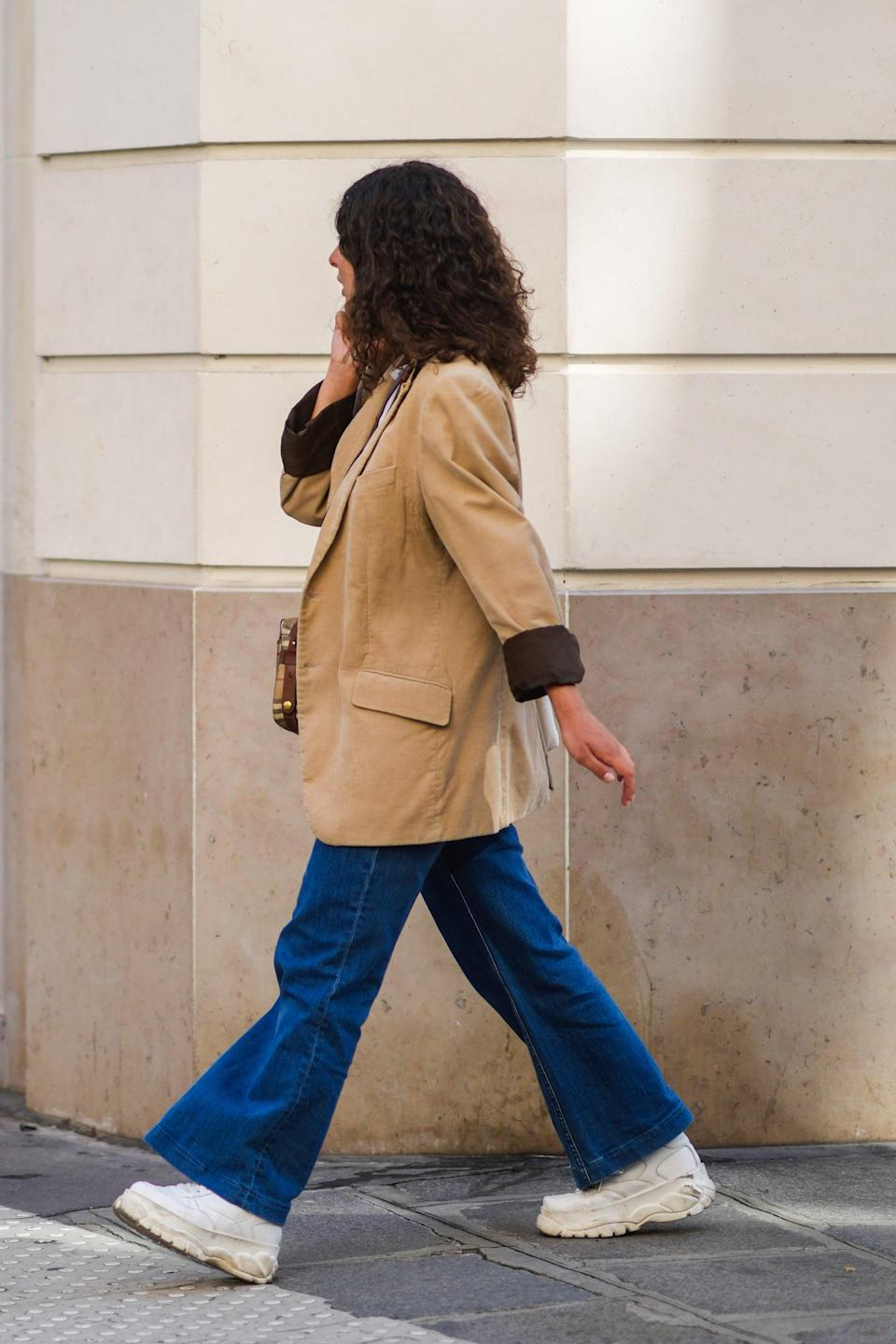 <p>Seventies-style bell-bottoms are making a serious comeback. Wearing them is one of the easiest ways to create a polished look, paired with either a cable knit, tank top, breezy blouse, or T-shirt. Channel your inner bohemian and complete them with a clog or platform boot. A lot of the styles come in stretch denim, too, so if rigid denim's just not for you, you're in luck.</p>