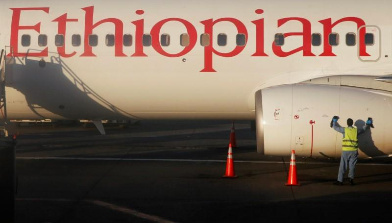 A worker services an Ethiopian Airlines plane at the Bole International Airport in Ethiopia's capital Addis Ababa